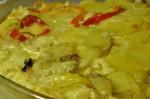 Cremede flødekartofler med løg, hvidløg, peberfrugt og ost
